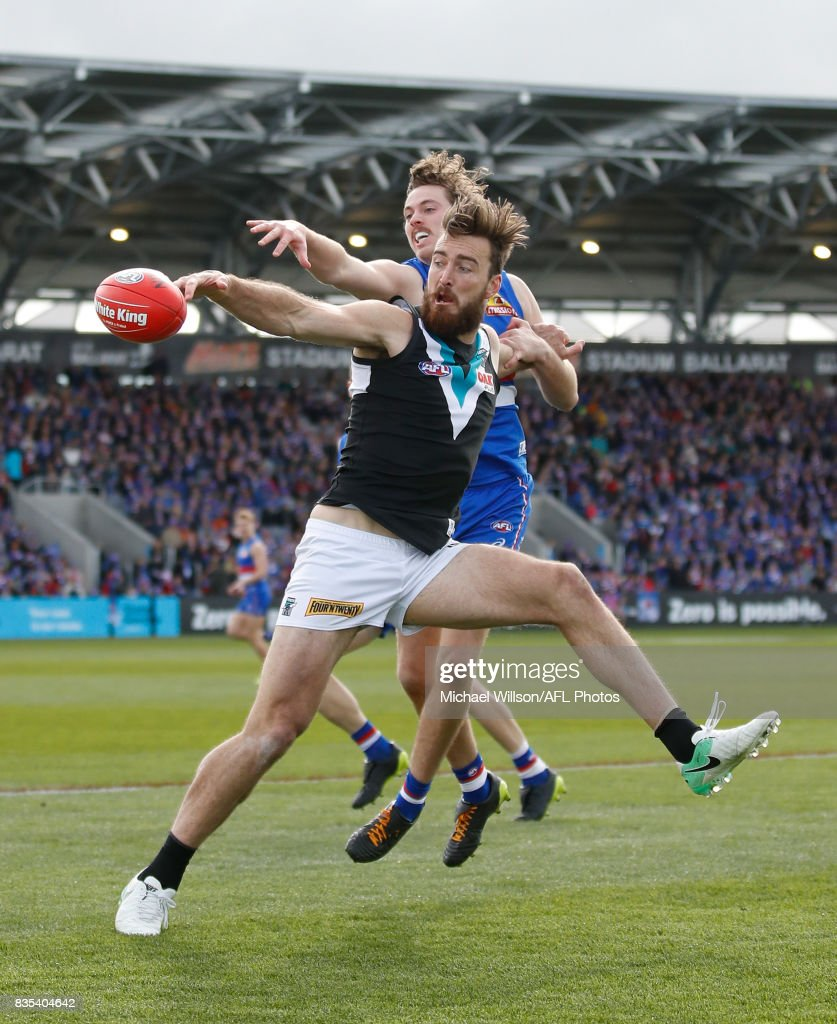 Charlie Dixon of the Power and Zaine Cordy of the Bulldogs compete for the ball during the 2017 AFL round 22 match between the Western Bulldogs and the Port Adelaide Power at Mars Stadium on August 19, 2017 in Ballarat, Australia.