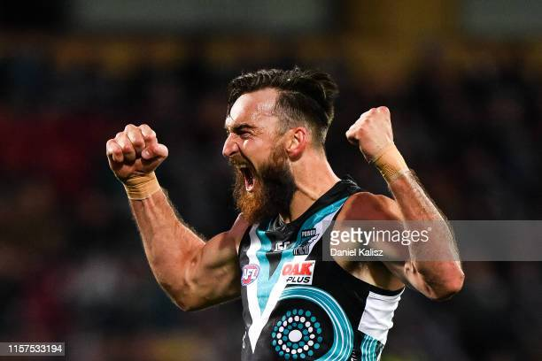 Charlie Dixon of the Power celebrates after kicking a goal during the round 14 AFL match between the Port Adelaide Power and the Geelong Cats at...