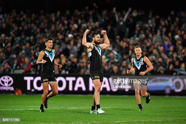 Charlie Dixon of the Power celebrates after kicking a goal during the round 23 AFL match between the Port Adelaide Power and the Gold Coast Suns at...