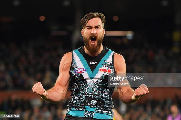 Charlie Dixon of the Power celebrates after kicking a goal during the round 12 AFL match between the Port Adelaide Power and the Richmond Tigers at...