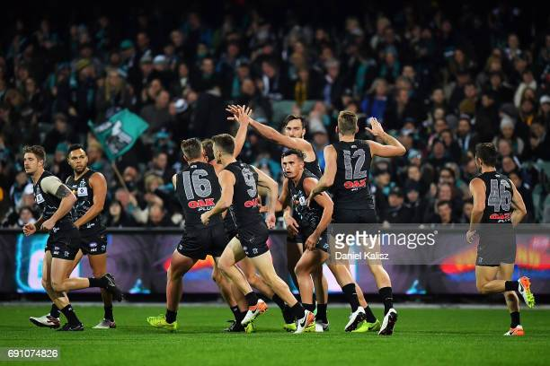 Charlie Dixon of the Power celebrates after scoring a goal during the round 11 AFL match between the Port Adelaide Power and the Hawthorn Hawks at...