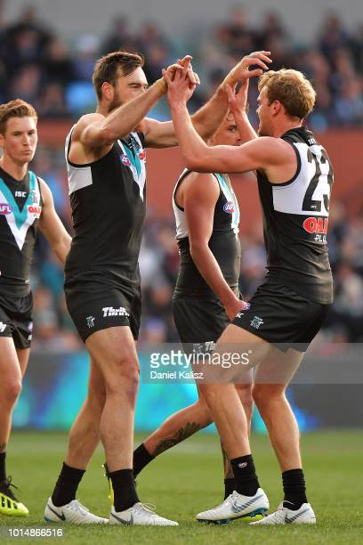 Charlie Dixon of the Power celebrates with Jack Watts of the Power during the round 21 AFL match between the Port Adelaide Power and the West Coast...