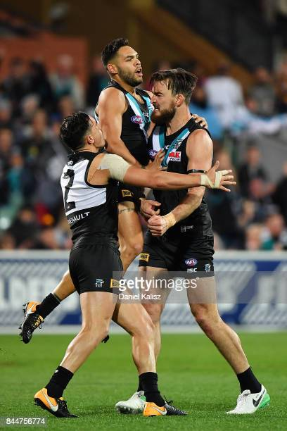 Charlie Dixon of the Power celebrates with Sam PowellPepper and Jarman Impey of the Power during the AFL First Elimination Final match between Port...