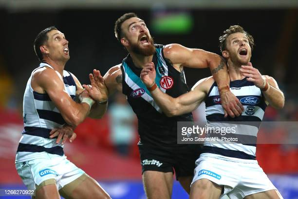 Charlie Dixon of the Power is wrapped up by Geelong defense during the round 12 AFL match between the Geelong Cats and the Port Adelaide Power at...