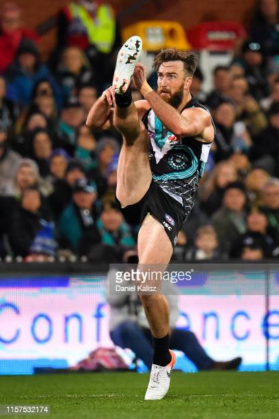 Charlie Dixon of the Power kicks the ball during the round 14 AFL match between the Port Adelaide Power and the Geelong Cats at Adelaide Oval on June...