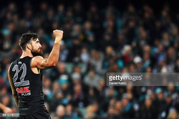 Charlie Dixon of the Power reacts after kicking a goal during the round 11 AFL match between the Port Adelaide Power and the Hawthorn Hawks at...