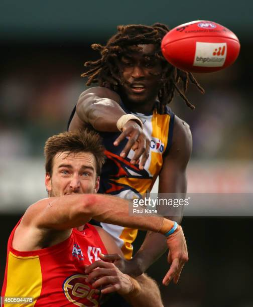 Charlie Dixon of the Suns and Nic Naitanui of the Eagles contest the ruck during the round 13 AFL match between the West Coast Eagles and the Gold...