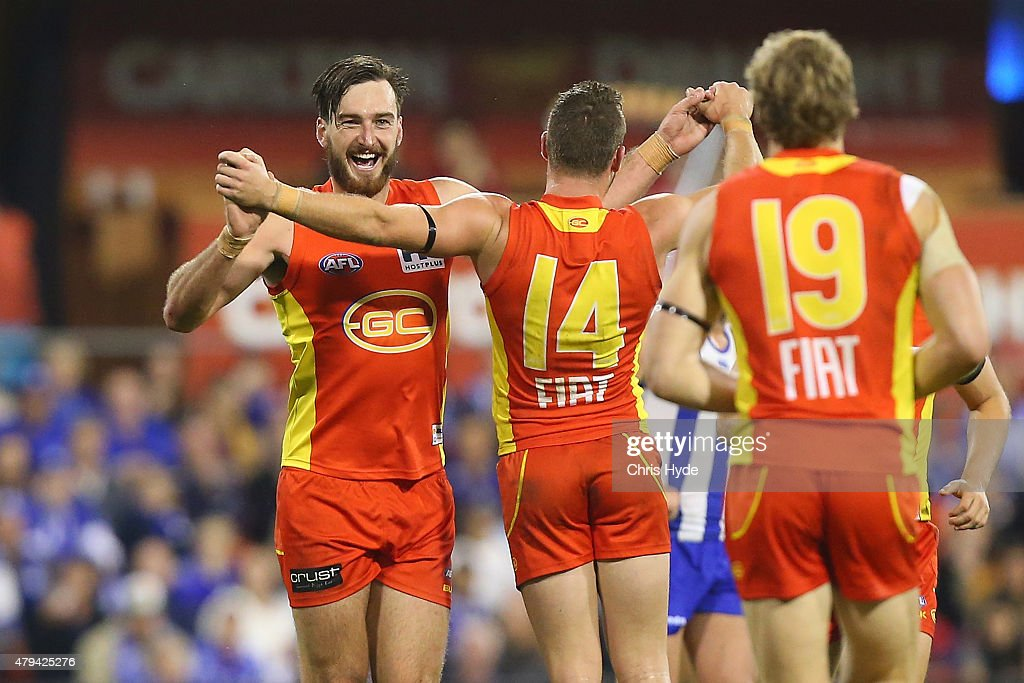 Charlie Dixon of the Suns celebrates a goal during the round 14 AFL match between the Gold Coast Suns and the North Melbourne Kangaroos at Metricon Stadium on July 4, 2015 in Gold Coast, Australia.