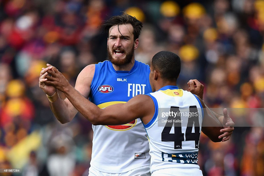 Charlie Dixon of the Suns celebrates with Took Miller of the Suns after scoring a goal during the round 17 AFL match between the Adelaide Crows and the GOld COast Titans at Adelaide Oval on July 25, 2015 in Adelaide, Australia.