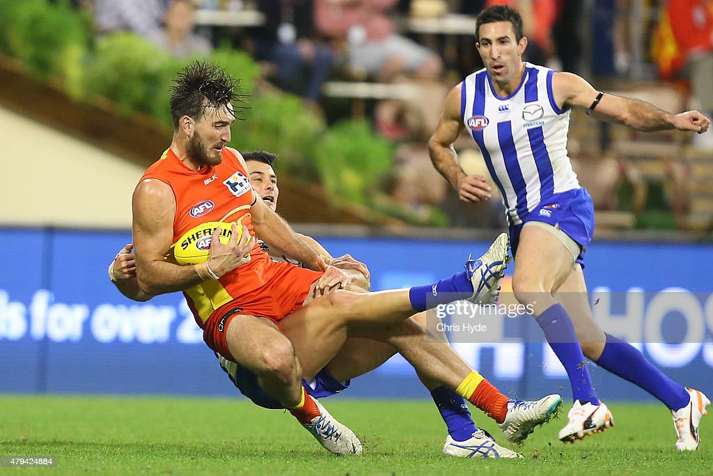 Charlie Dixon of the Suns marks during the round 14 AFL match between the Gold Coast Suns and the North Melbourne Kangaroos at Metricon Stadium on July 4, 2015 in Gold Coast, Australia.