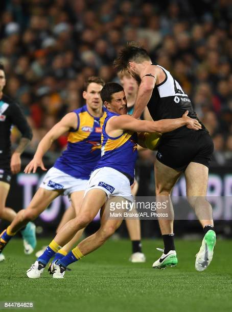 Charlie Dixon shrugs off a tackle from Liam Duggan during the AFL First Elimination Final match between Port Adelaide Power and West Coast Eagles at...