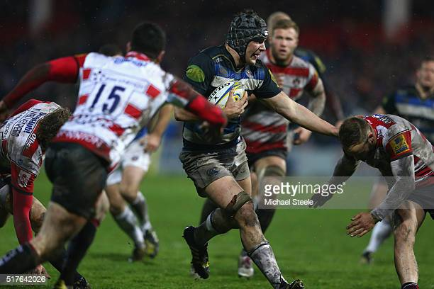 Charlie Ewels of Bath fends off Bill Meakes of Gloucester as Tom Marshall closes in during the Aviva Premiership match between Gloucester and Bath at...