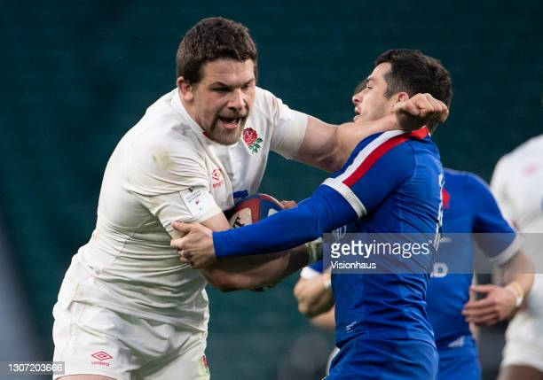 Charlie Ewels of England and Brice Dulin of France during the Guinness Six Nations match between England and France at Twickenham Stadium on March...