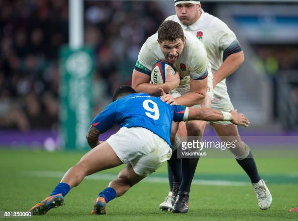 Charlie Ewels of England is tackled by Dwayne Polataivao of Samoa during the Old Mutual Wealth Series autumn international match between England and...
