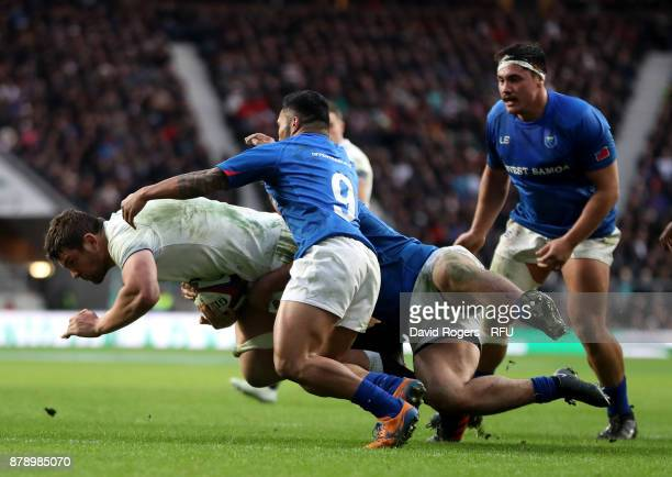 Charlie Ewels of England touches downn for the third try while being tackled by Dwayne Polataivao of Samoa during the Old Mutual Wealth Series match...