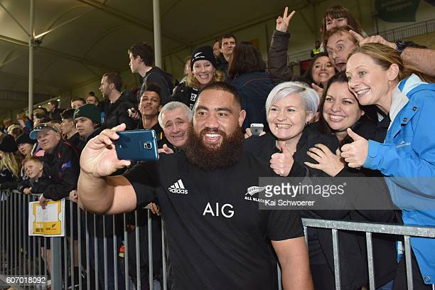 Charlie Faumuina of the All Blacks takes a selfie with fans following the Rugby Championship match between the New Zealand All Blacks and the South...
