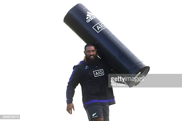 Charlie Faumuina of the All Blacks with a tackle bag during a New Zealand All Blacks training session at Trusts Stadium on May 31 2016 in Auckland...