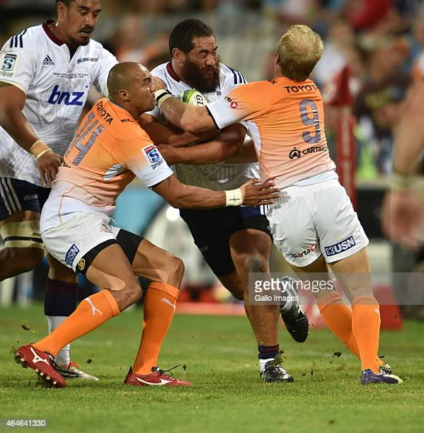 Charlie Faumuina of the Blues and Cornal Hendricks with Sarel Pretorius of the Cheetahs during the Super Rugby match between Toyota Cheetahs and...