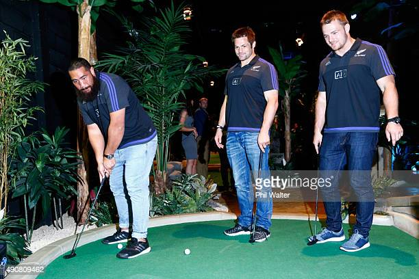 Charlie Faumuina Richie McCaw and Sam Cane of the All Blacks play Mini Golf courtesy of sponsor AIG at Treetop Adventure Golf on October 1 2015 in...