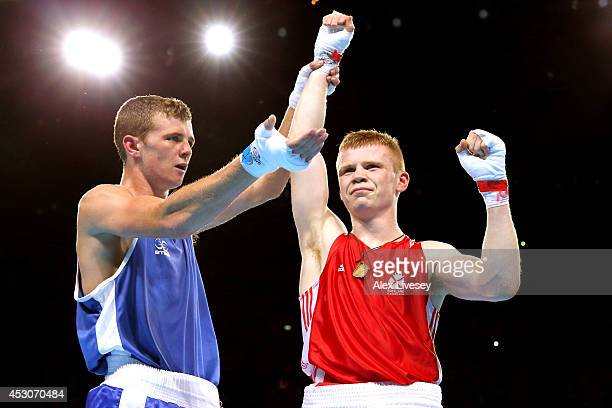 Charlie Flynn of Scotland celebrates winning the gold medal against Joe Fitzpatrick of Northern Ireland in the Men's Light Final at SSE Hydro during...