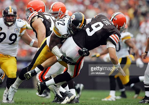 Charlie Frye of the Cleveland Browns is sacked by James Harrison of the Pittsburgh Steelers during their season opening game at Cleveland Browns...