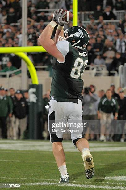 Charlie Gantt of the Michigan State Spartans catches a game-winning touchdown pass from teammate Aaron Bates on a fake field goal attempt in overtime...