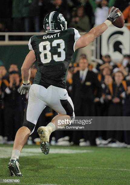 Charlie Gantt of the Michigan State Spartans scores the game-winning touchdown on a pass from teammate Aaron Bates on a fake field goal attempt in...