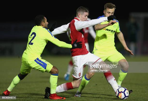 Charlie Gilmour of Arsenal is challenged by Ikechi Anya of Derby and Alex Babos of Derby during the Premier League 2 match between Arsenal and Derby...