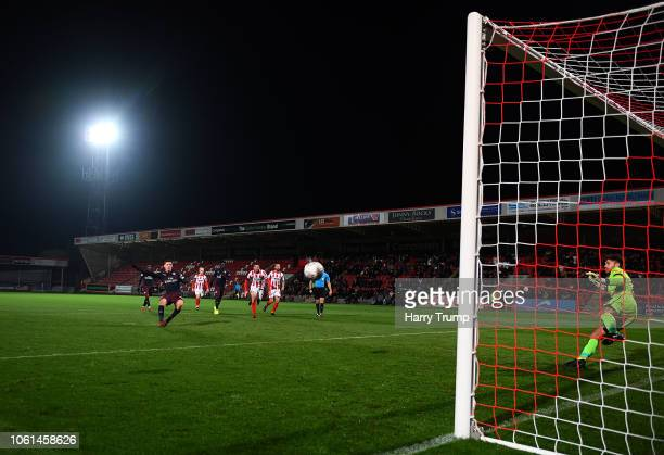Charlie Gilmour of Arsenal U21 scores his sides second goal during the Checkatrade Trophy match between Cheltenham Town and Arsenal U21 at Whaddon...