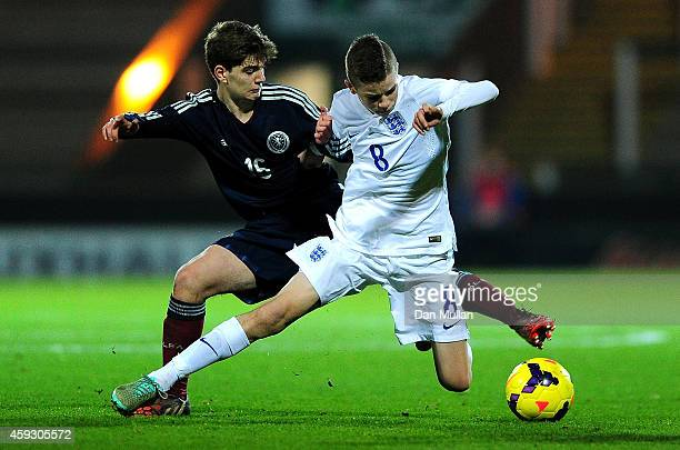 Charlie Gilmour of England battles for the ball with Kristi Marku of Scotland during the Victory Shield match between England U16 and Scotland U16 at...