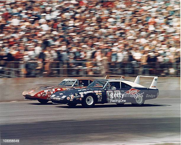 Charlie Glotzbach and Bobby Allison race sideby side in their Dodge Charger Daytonas Allison and Glotzbach finished third and fourth respectively in...