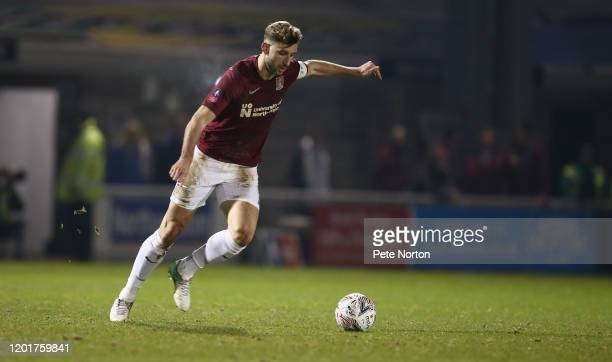 Charlie Goode of Northampton Town in action during the FA Cup Fourth Round match between Northampton Town and Derby County at PTS Academy Stadium on...