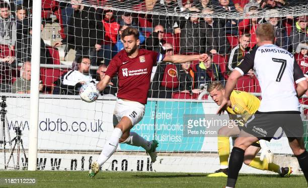 Charlie Goode of Northampton Town looks to clear the ball during the Sky Bet League Two match between Northampton Town and Salford City at PTS...