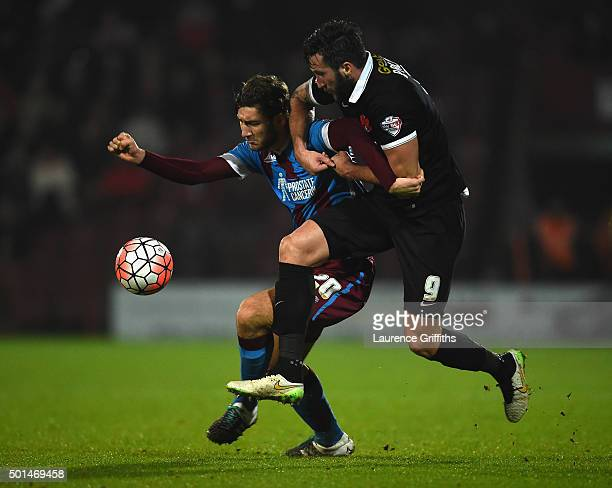 Charlie Goode of Scunthorpe United battes with Ollie Palmer of Leyton Orient during The Emirates FA Cup Second Round Replay between Scunthorpe United...