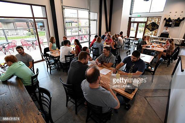 Charlie Gottenkieny and Ryan Evans owners of Bruz Beer in the new Midtown neighborhood hold trivia night August 10 2016 at their brewery The Brewery...