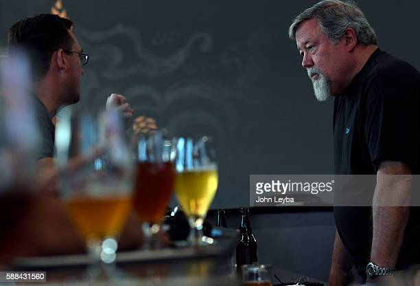 Charlie Gottenkieny owner of Bruz Beer in the new Midtown neighborhood talks with customers during trivia night August 10 2016 at their brewery The...