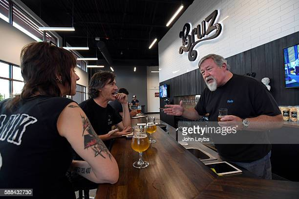 Charlie Gottenkieny owner of Bruz Beer in the new Midtown neighborhood talks with Mary Ellen Tuttle and Charles Tuttle during trivia night August 10...