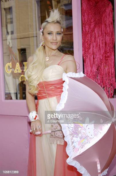 Charlie Green displays a 'Hello Kitty' parasol while adorned with an assortment of 'Hello Kitty' Accessories