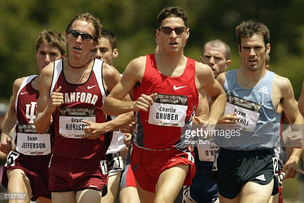 Charlie Gruber of Nike leads Grant Robison of the Stanford University Cardinal and Bryan Berryhill of Adidas in the men's 1500m during the USA...