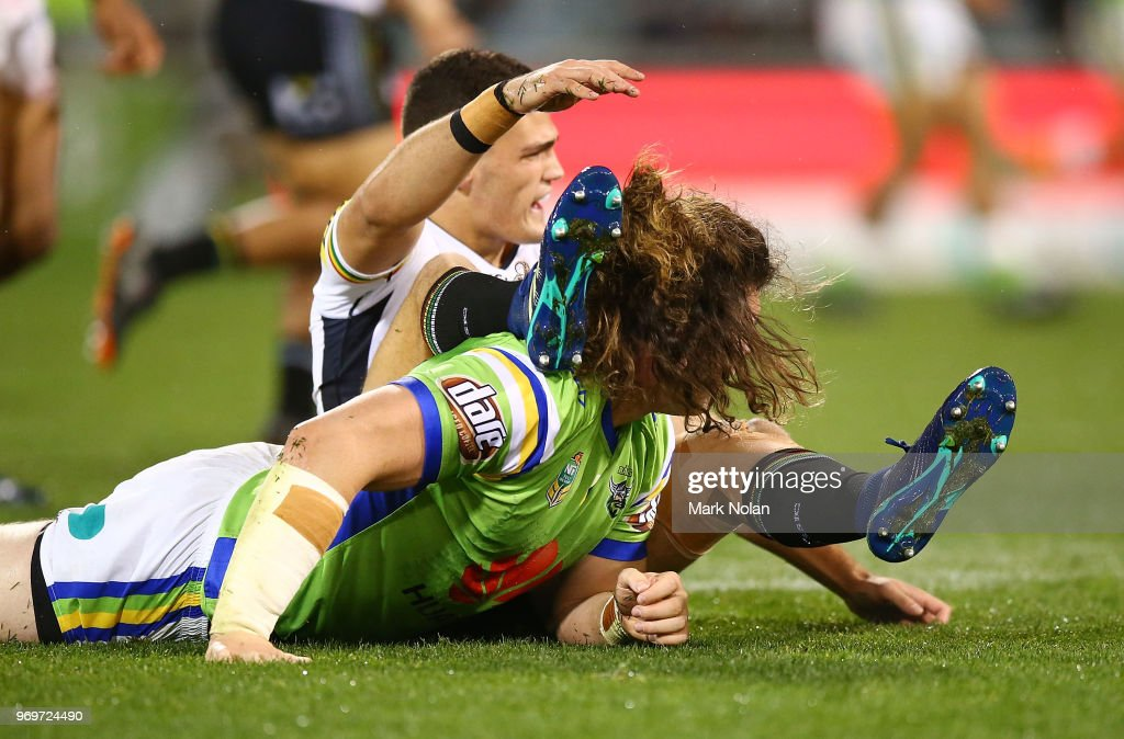 Charlie Gubb of the Raiders tackles the legs of Nathan Cleary of the Panthers as he kicked the ball during the round 14 NRL match between the Canberra Raiders and the Penrith Panthers at GIO Stadium on June 8, 2018 in Canberra, Australia.