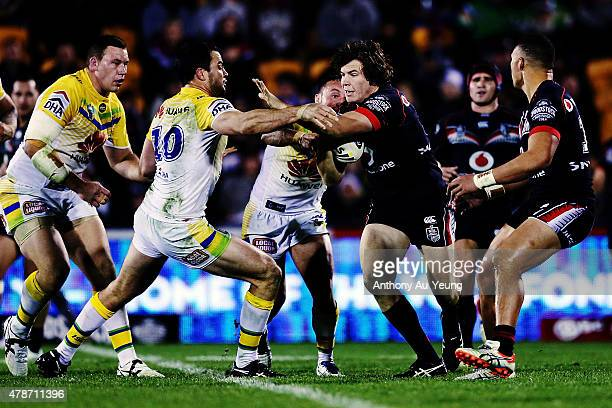 Charlie Gubb of the Warriors charges at David Shillington of the Raiders during the round 16 NRL match between the New Zealand Warriors and the...