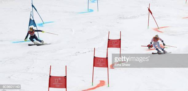 Charlie Guest of Great Britain and Megan McJames of the United States compete during the Alpine Team Event 1/8 Finals on day 15 of the PyeongChang...