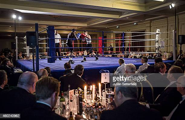 Charlie Harrison of Fitzroy Lodge ABC competes with Joshua Nelson of Palmers ABC during his bout at an amateur fight at the Millennium Hotel London...