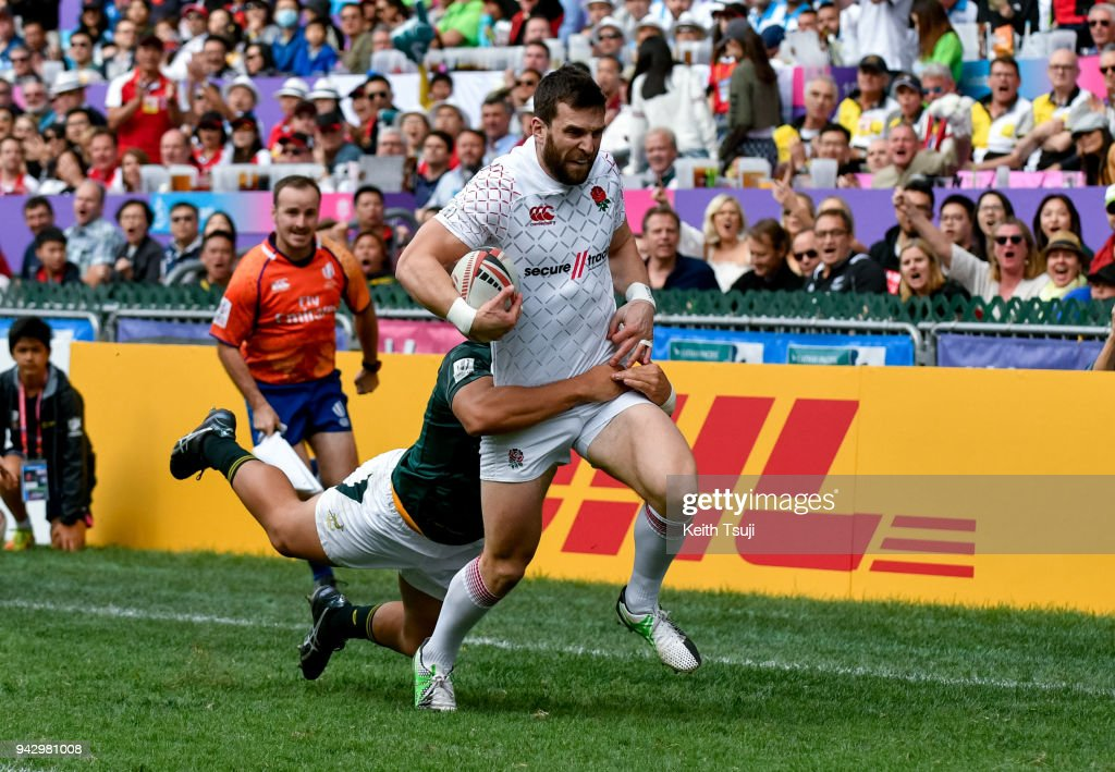 Charlie Hayter of England is tackled during their match against South Africa on the second day of the Hong Kong Sevens on April 7, 2018 in Hong Kong.