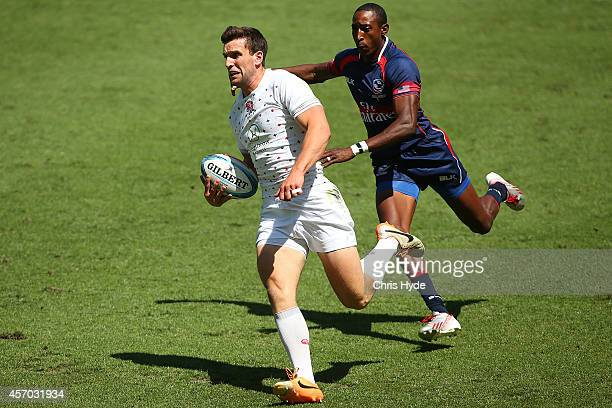 Charlie Hayter of England makes a break to score a try during the 2014 Gold Coast Sevens Pool D match between England and United States at Cbus Super...