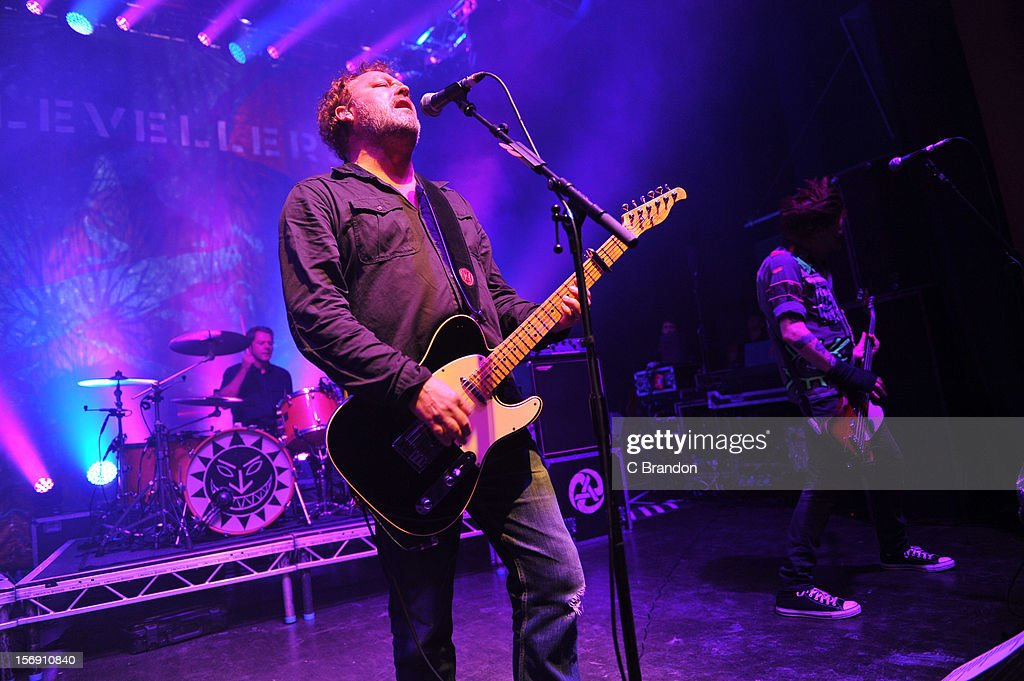 Charlie Heather, Mark Chadwick and Jeremy Cunningham of The Levellers perform on stage at O2 Shepherd's Bush Empire on November 24, 2012 in London, England.