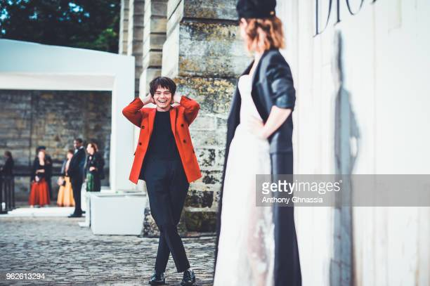 Charlie Heaton and Natalia Dyer attend a photocall during Christian Dior Couture S/S19 Cruise Collection on May 25 2018 in Chantilly France
