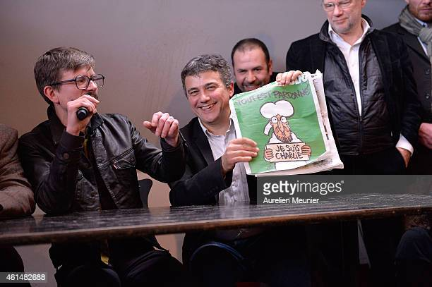 Charlie Hebdo cartoonist Renald Luzier aka Luz and Patrick Pelloux Charlie Hebdo journalist during the Charlie Hebdo press conference held at the...