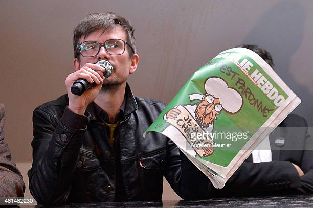Charlie Hebdo cartoonist Renald Luzier aka Luz speaks during a Charlie Hebdo press conference held at the Liberation offices in Paris on January 13...