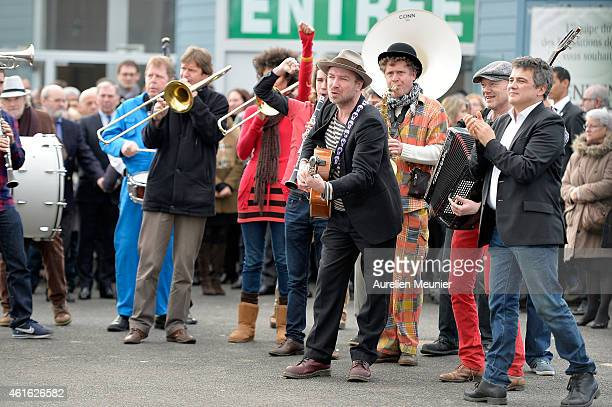 Charlie Hebdo journalist Patrick Pelloux claps along to the music of a live band after the funeral service of Charlie Hebdo editor and cartoonist...